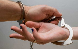 Couple in handcuffs