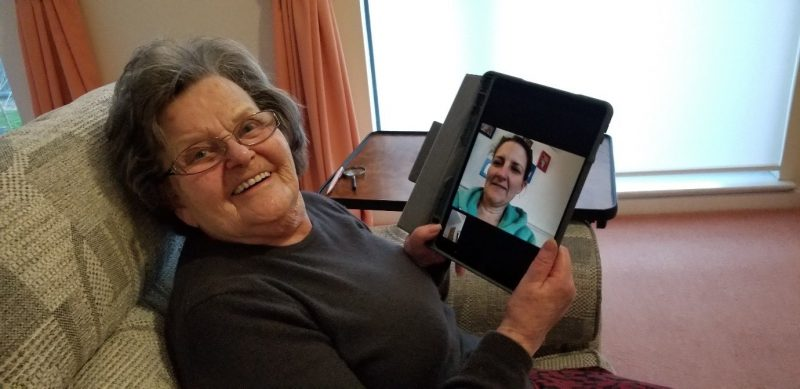 Picture of an older woman using an iPad