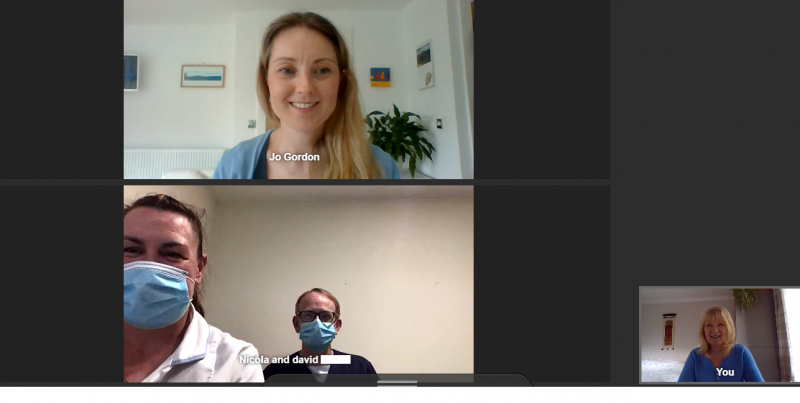 3 women and a man taking part in a video call