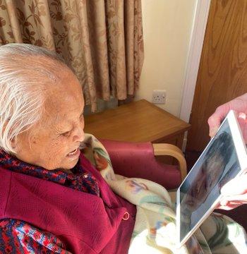 Grandmother using iPad to speak to her Grandson